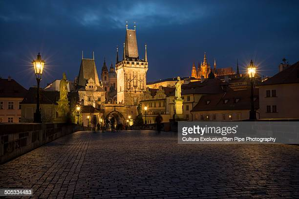 Charles Bridge with Prague Castle in background at night, Prague, Czech Republic