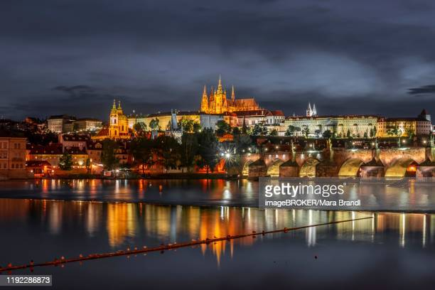 charles bridge with vltava, st vitus cathedral and prague castle, hradcany, old town, night view, prague, bohemia, czech republic - historic district stock pictures, royalty-free photos & images