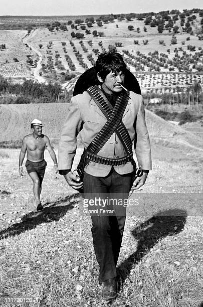 Charles Bronson during a break from the filming of the movie 'Wild Horses' directors John Sturges and Duilio Coletti First December 1972 Almeria Spain