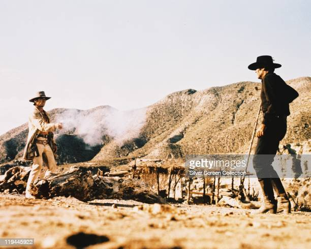Charles Bronson US actor shooting Henry Fonda US actor in a publicity still from the film 'Once Upon a Time in the West' USA 1968 The western...