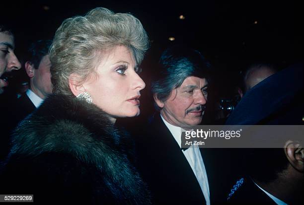 Charles Bronson with his wife Jill Ireland he is in a tux she is wearing a fur; circa 1970; New York.