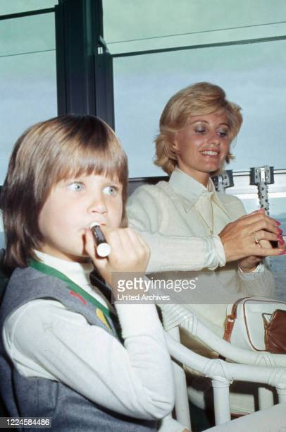 Charles Bronson's wife Jill Ireland with daughter Zuleika Bronson at a restaurant, France, 1970s.