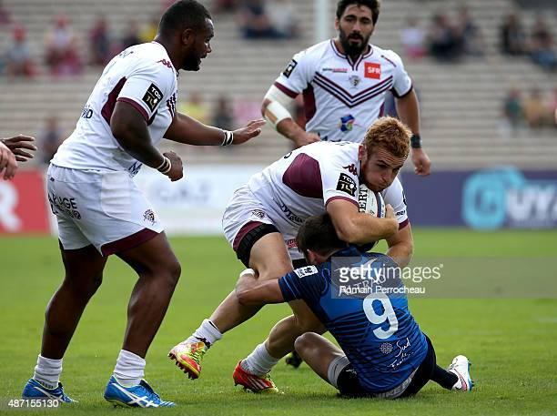 Charles Brousse of Union Bordeaux Begles is tackled by Benoit Paillaugue of Montpellier during the French Rugby League Top 14 between Union Bordeaux...