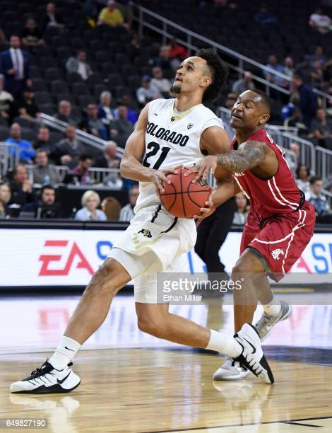 Charles Callison of the Washington State Cougars tries to steal the ball from Derrick White of the Colorado Buffaloes during a firstround game of the...