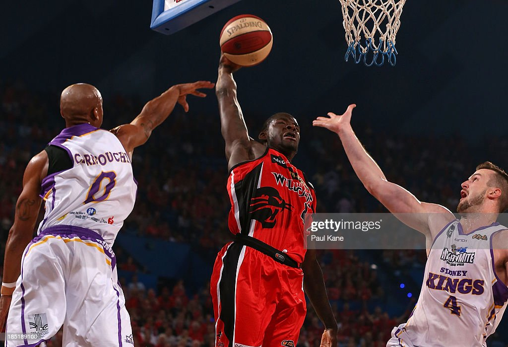 Charles Carmouche and AJ Ogilvy of the Kings look to block James Ennis of the Wildcats during the round two NBL match between the Perth Wildcats and the Sydney Kings at Perth Arena in October 18, 2013 in Perth, Australia.