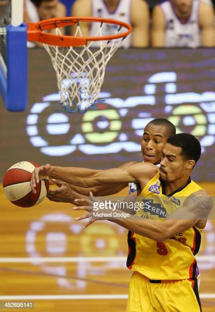 Charles Carmouche of the Kings and Mustapha Farrakhan of the Tigers contest for the ball during the round eight NBL match between the Melbourne...
