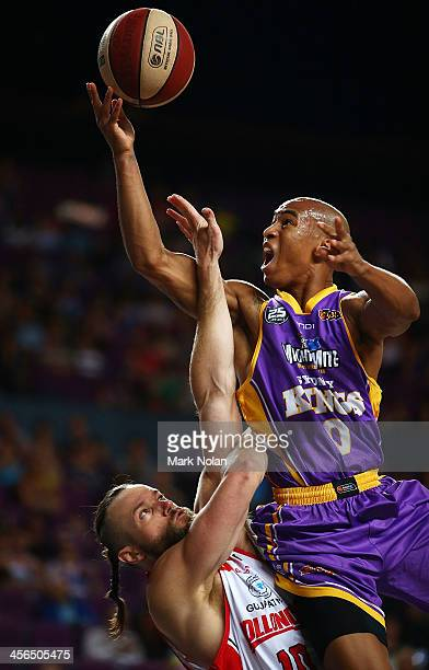 Charles Carmouche of the Kings drives to the basket as Larry Davidson of the Hawks defends during the round 10 NBL match between the Sydney Kings and...