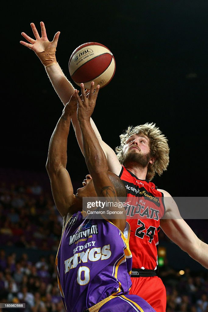 Charles Carmouche of the Kings is blocked by Jesse Wagstaff of the Wildcats during the round three NBL match between the Sydney Kings and the Perth Wildcats at Sydney Entertainment Centre in October 27, 2013 in Sydney, Australia.