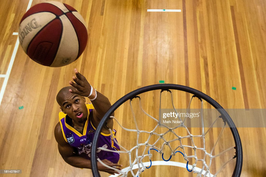 Charles Carmouche of the Kings lays up before the 2013/14 Pre-season Blitz match between the Sydney Kings and the New Zealand Breakers at the North Sydney Indoor Sports Centre on September 21, 2013 in Sydney, Australia.