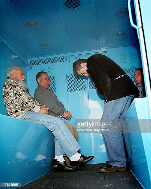 Charles Carneglia Joseph Corozzo and Frank Cali sit inside a police paddywagon outside the FBI's New York Field Office at 26 Federal Plaza after the...