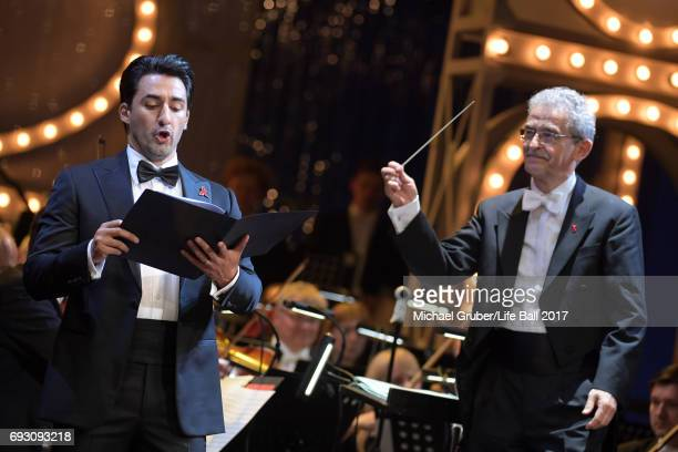 Charles Castronovo and conductor Alfred Eschwe perform on stage during the Life Celebration Concert at Burgtheater on June 6 2017 in Vienna Austria...