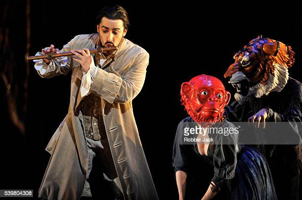 Charles Castronovo as Tamino with artists of the company in the Royal Opera's production of Wolfgang Amadeus Mozart's Die Zauberflote directed by...