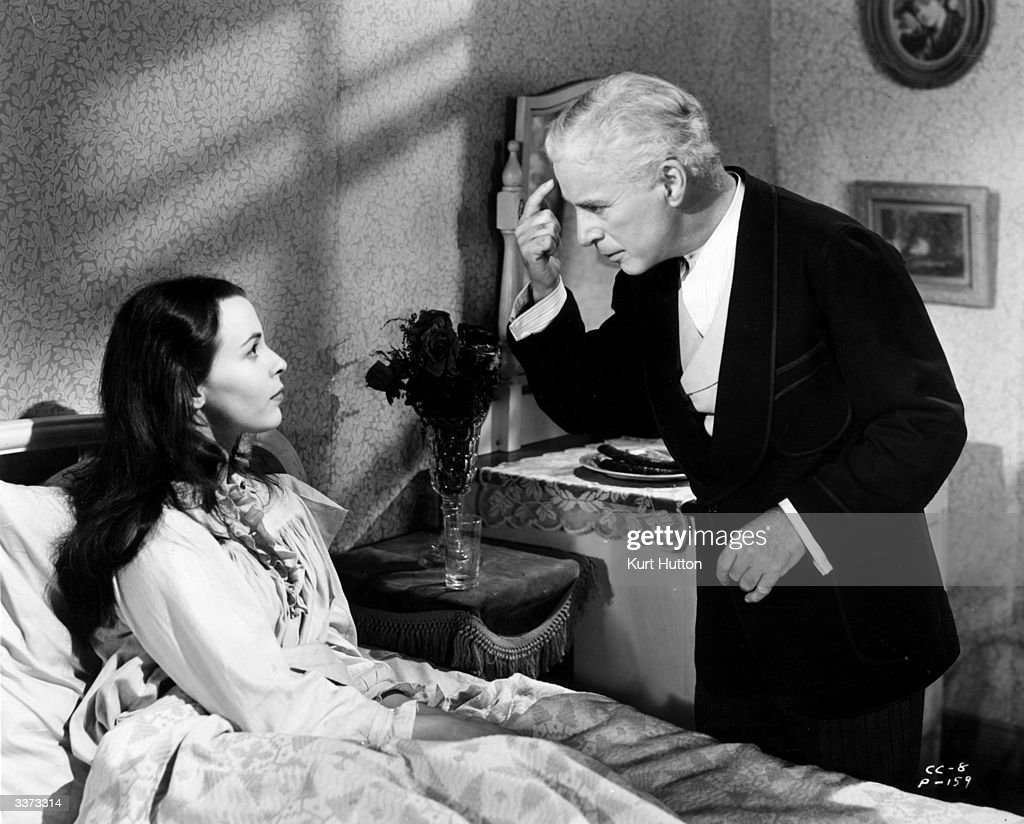 Charles Chaplin (1889 - 1977) and Claire Bloom in a bedside scene from the film 'Limelight', about a broken-down music hall comedian who is stimulated by a ballerina into a final hour of triumph. The film was directed by Chaplin himself for United Artists. Original Publication: Picture Post - 6099 - Chaplin D P - pub. 1952