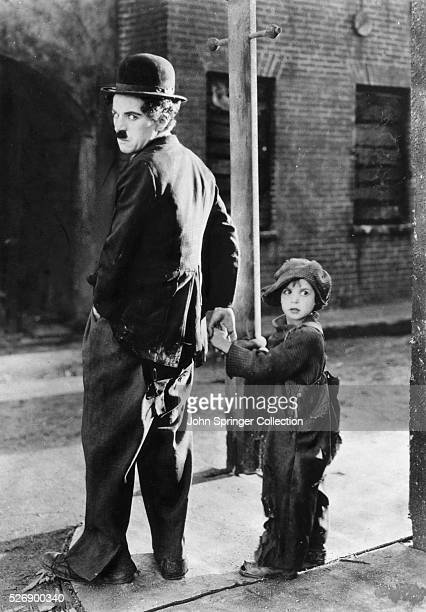 Charles Chaplin and Jackie Coogan in The Kid
