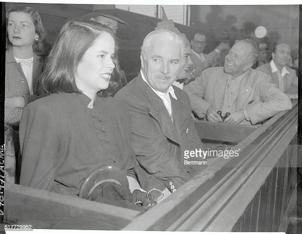 Charles Chaplin and Wife at Tennis Match Los Angeles CACharlie Chaplin and his wife Oona O'Neill daughter of the famous playwright view the $5000...