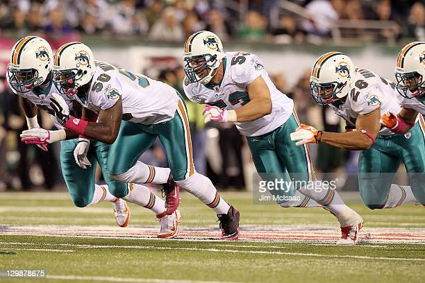 Charles Clay Marvin Mitchell Austin Spitler and Lex Hilliard of the Miami Dolphins in action against the New York Jets on October 17 2011 at MetLife...