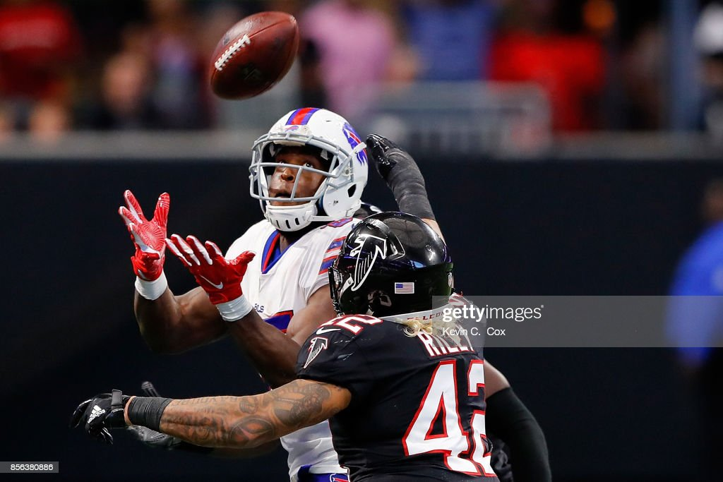 Charles Clay #85 of the Buffalo Bills catches a pass against Duke Riley #42 of the Atlanta Falcons during the second half at Mercedes-Benz Stadium on October 1, 2017 in Atlanta, Georgia.