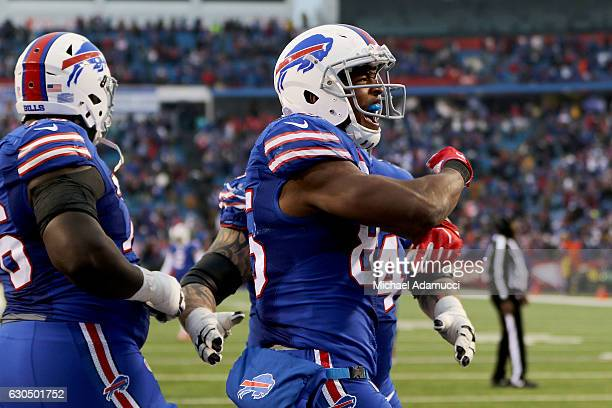 Charles Clay of the Buffalo Bills celebrates a touchdown catch against the Miami Dolphins during the second half at New Era Stadium on December 24...