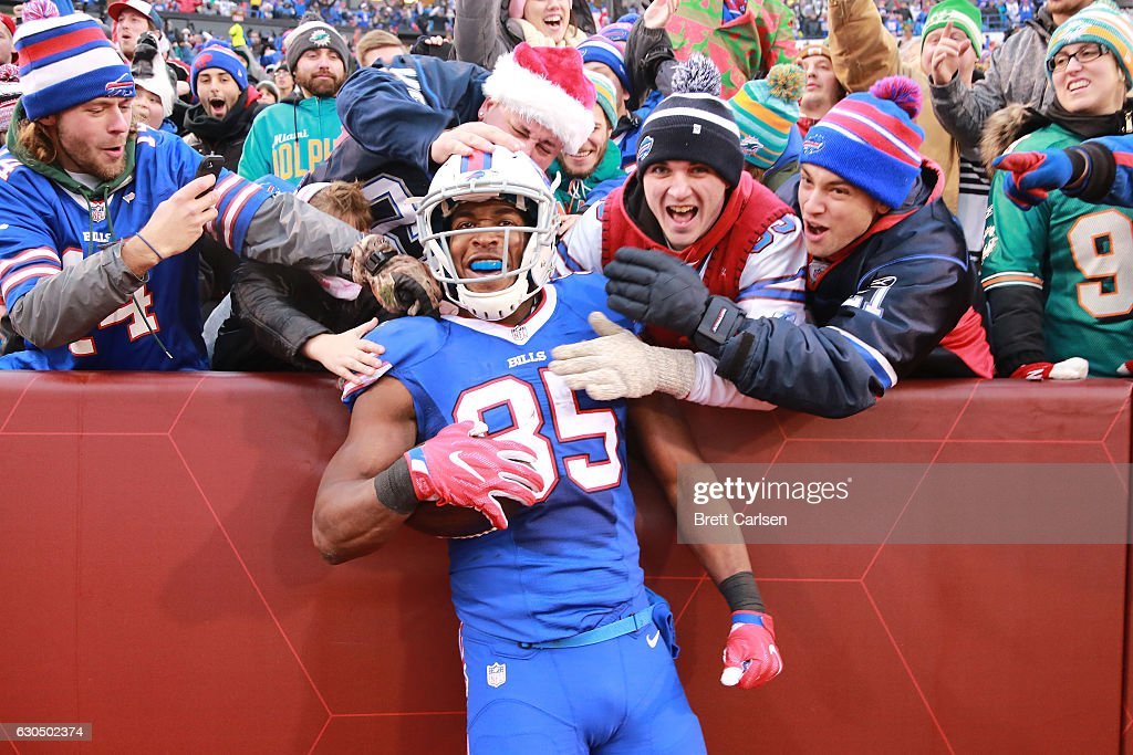 Charles Clay #85 of the Buffalo Bills celebrates a touchdown catch against the Miami Dolphins during the second half at New Era Stadium on December 24, 2016 in Orchard Park, New York. The touchdown was later called back after officials ruled that both feet were not within bounds.