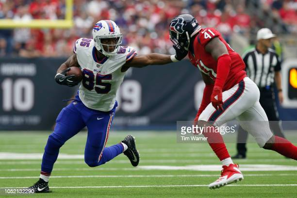 Charles Clay of the Buffalo Bills gives a stiff arm to Zach Cunningham of the Houston Texans in the first half at NRG Stadium on October 14 2018 in...