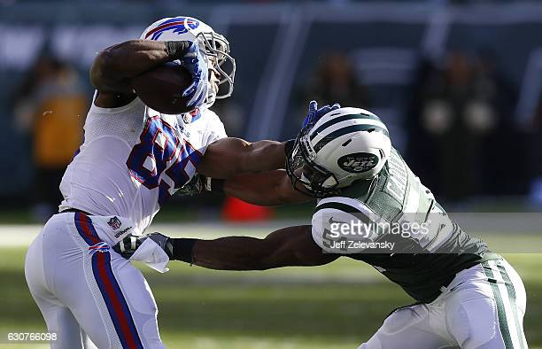 Charles Clay of the Buffalo Bills grapples with Bruce Carter of the New York Jets at MetLife Stadium on January 1 2017 in East Rutherford New Jersey