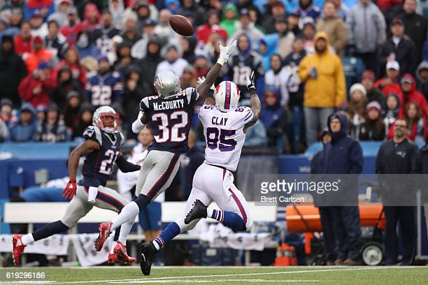 Charles Clay of the Buffalo Bills has a pass broken up by Devin McCourty of the New England Patriots during the first half at New Era Field on...