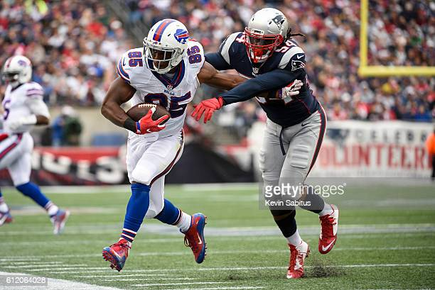 Charles Clay of the Buffalo Bills is forced out of bounds by Dont'a Hightower of the New England Patriots in the first quarter at Gillette Stadium on...