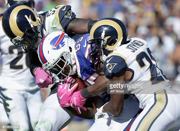 Charles Clay of the Buffalo Bills is stopped by Lamarcus Joyner and Alec Ogletree of the Los Angeles Rams during the second quarter of the game at...