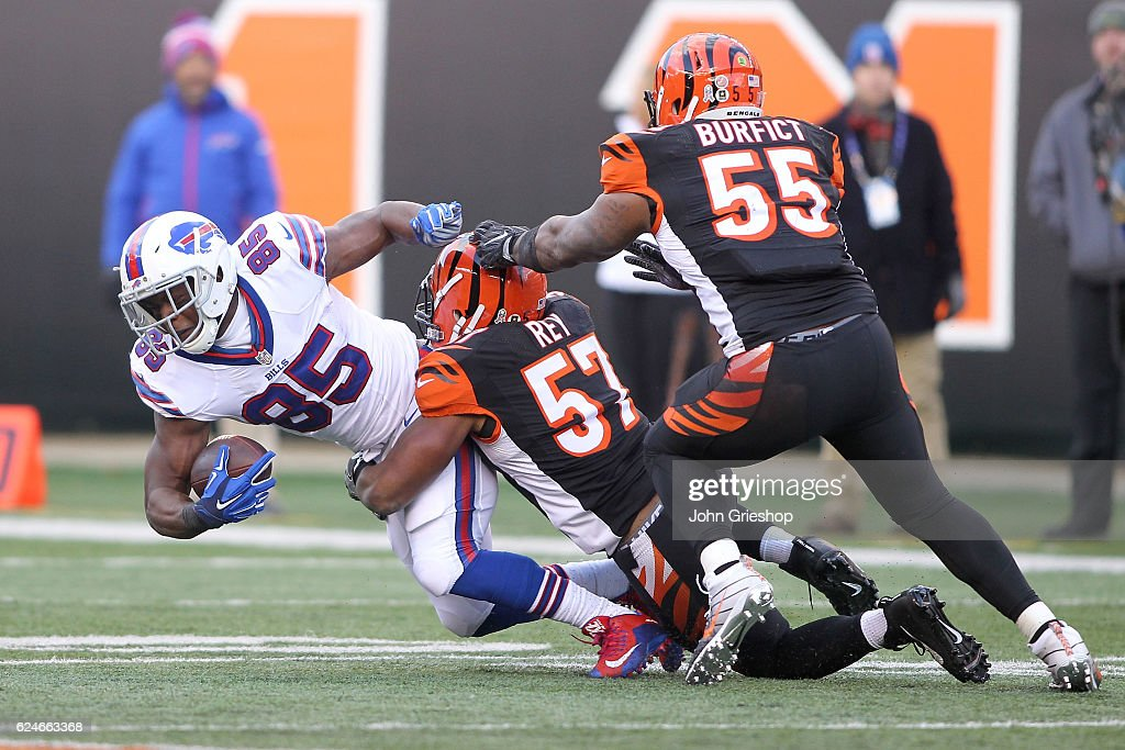 Charles Clay #85 of the Buffalo Bills is tackled by Vincent Rey #57 of the Cincinnati Bengals during the third quarter at Paul Brown Stadium on November 20, 2016 in Cincinnati, Ohio.