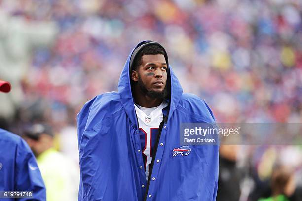 Charles Clay of the Buffalo Bills is walked off the field after being inujured against the New England Patriots during the first half at New Era...