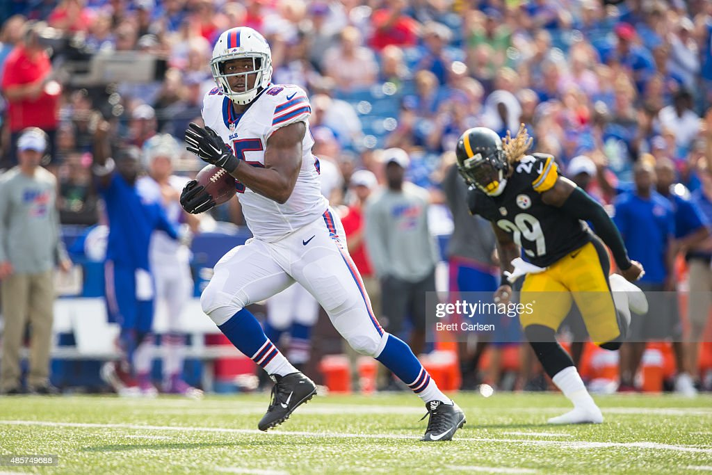 Charles Clay #85 of the Buffalo Bills runs in a touchdown reception to push the Bills ahead 13-8 against the Pittsburgh Steelers preseason game on August 29, 2015 at Ralph Wilson Stadium in Orchard Park, New York.