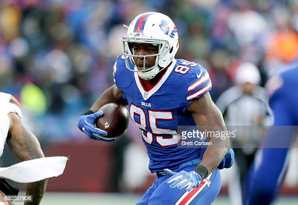 Charles Clay of the Buffalo Bills runs the ball after the catch against the Cleveland Browns during the first half at New Era Field on December 18...