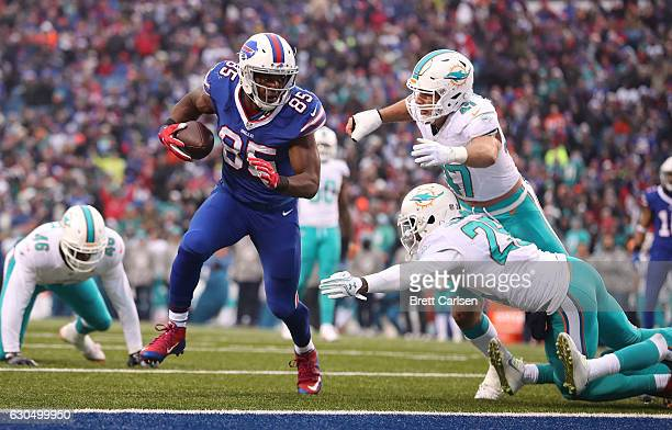 Charles Clay of the Buffalo Bills scores a touchdown during the second half at New Era Stadium on December 24 2016 in Orchard Park New York