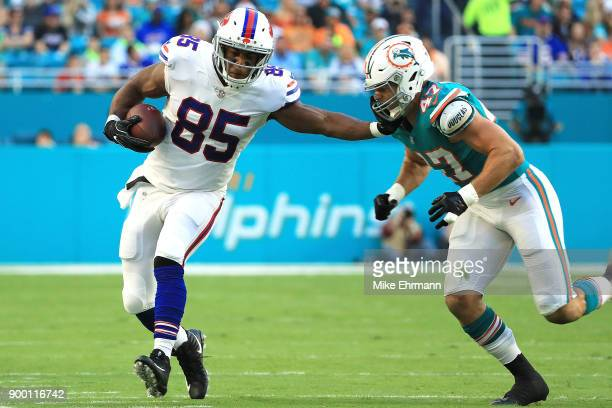 Charles Clay of the Buffalo Bills stiff arms Kiko Alonso of the Miami Dolphins during the first quarter at Hard Rock Stadium on December 31 2017 in...