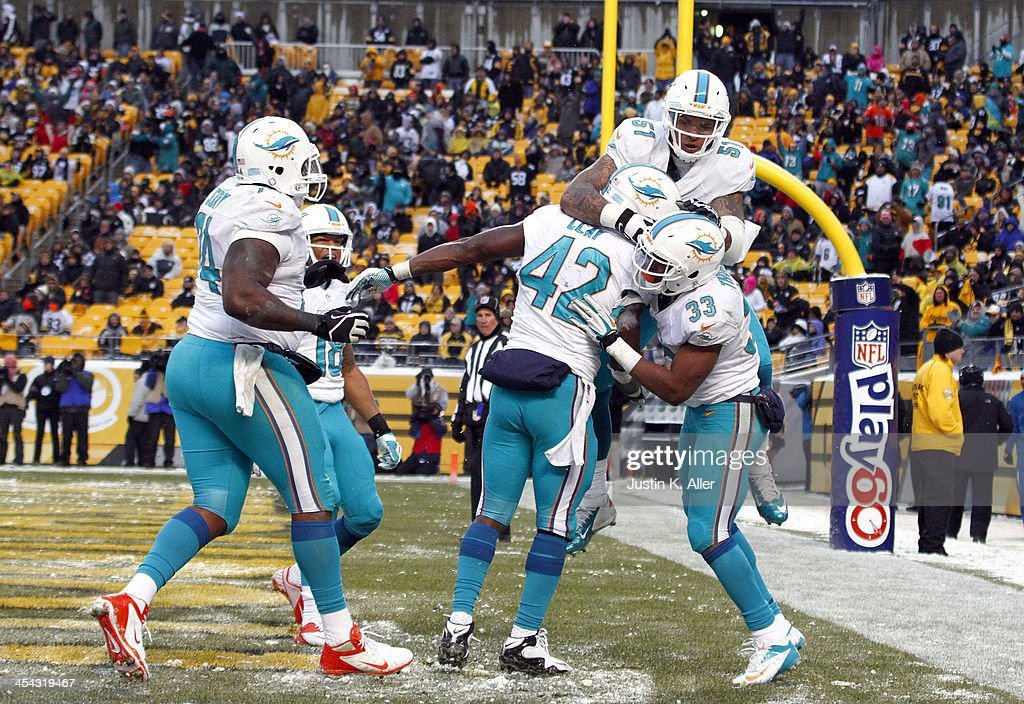 Charles Clay #42 of the Miami Dolphins celebrates after scoring on a 12 yards touchdown pass against the Pittsburgh Steelers during the game on December 8, 2013 at Heinz Field in Pittsburgh, Pennsylvania.