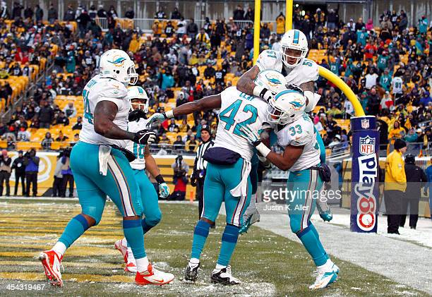 Charles Clay of the Miami Dolphins celebrates after scoring on a 12 yards touchdown pass against the Pittsburgh Steelers during the game on December...
