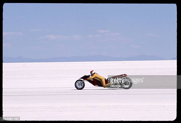 Charles Clupper races an AA/Fuel Three Wheeler modified motorcycle with a 2000cc engine at the Bonneville Salt Flats in Utah at over 182 miles per...