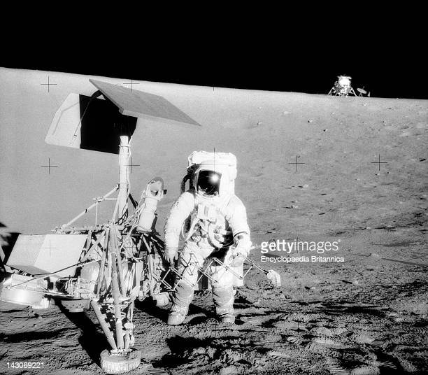 Charles Conrad Jr On The Moon Charles Conrad Jr Apollo 12 Commander Examines The Unmanned Surveyor Iii Spacecraft The Lunar Module Intrepid Is In The...