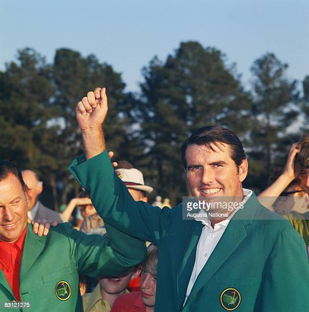 Charles Coody raises his hand in victory aside former Green Jacket winner Billy Casper during the 1971 Masters Tournament at Augusta National Golf...