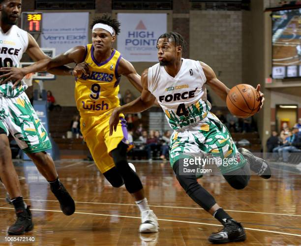 6c7047111 Charles Cooke III of the Sioux Falls Skyforce handles the ball against Jemerrio  Jones from the