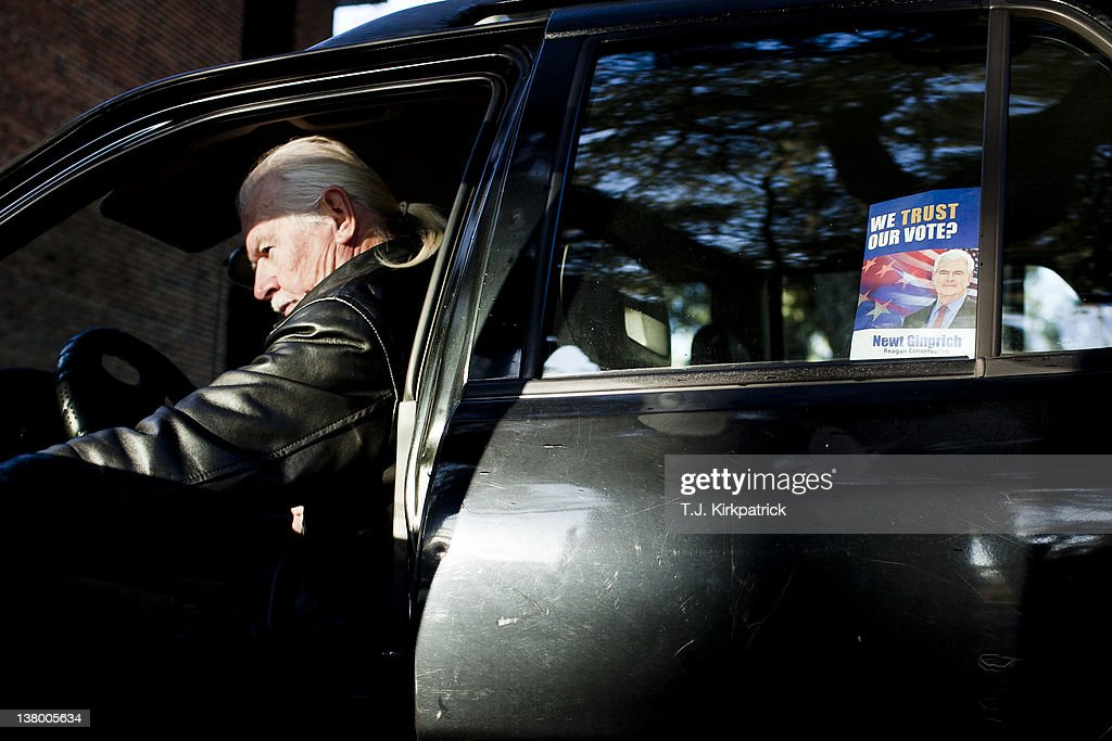 Charles Cooke, of Micanopy, Fla., climbs into his car after voting in the state's Republican party primary on January 31, 2012 at the Micanopy Town Hall in Micanopy, Fla. After a decisive South Carolina win, former House speaker Newt Gingrich has risen and fallen in the polls and trails former Massachusetts Gov. Mitt Romney by double digits going in to Florida's primary.
