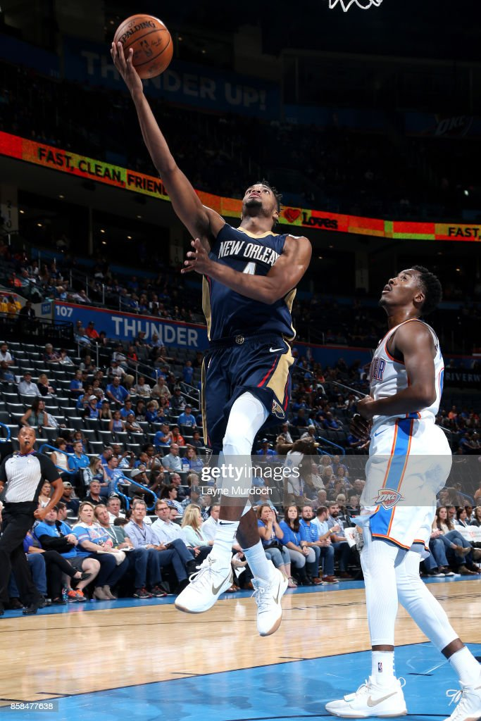 Charles Cooke #4 of the New Orleans Pelicans shoots a lay up during the game against the Oklahoma City Thunder during a preseason game on October 6, 2017 at Chesapeake Energy Arena in Oklahoma City, Oklahoma.
