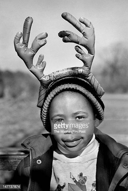 FILE Charles Custis gets into the holiday mood with his inflated reindeer antler headgear at a community gettogether held in Bayview Virginia on...