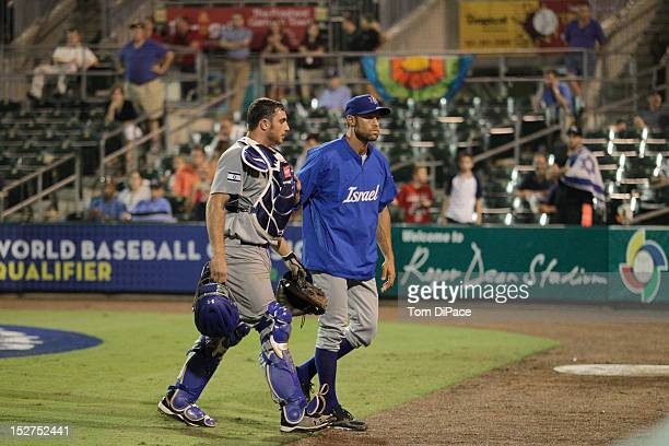 Charles Cutler of Team Israel is walked off the field by Gabe Kapler of Team Israel game 6 of the Qualifying Round of the World Baseball Classic at...