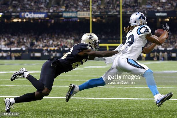Charles D Johnson of the Carolina Panthers attempts to catch the ball as Ken Crawley of the New Orleans Saints defends during the first half of the...