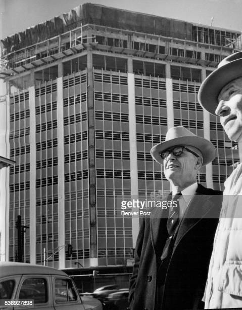 Charles D Strong architect for the new Petroleum Club building and Carl 'Red' Walters job superintendent for N G Petry Co general contractors pose in...