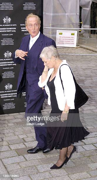 Charles Dance and Dame Judi Dench during Royal Academy Summer Exhibition 2005 Preview Party Arrivals at Royal Academy Of Arts in London Great Britain