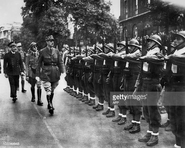 Charles de Gaulle , Chief of the French Free Forces, inspects the French troops during the military parade celebrating the French National Day in...