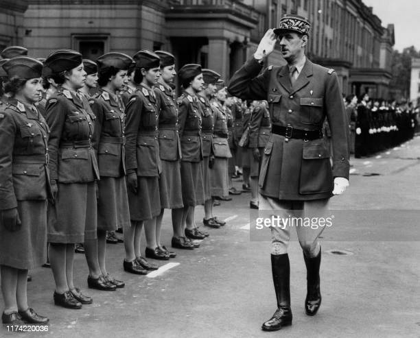Charles de Gaulle , Chief of the French Free Forces, passes by women soldiers as he inspects the French troops during the military parade celebrating...