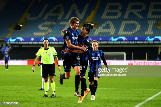 Charles De Ketelaere of Club Brugge KV celebrates scoring his teams first goal of the game with team mates Federico Ricca and Noa Lang during the...